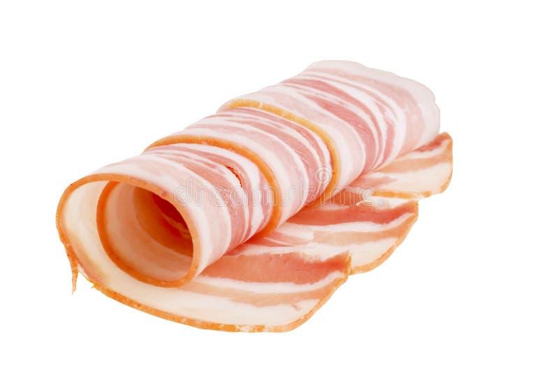 Alimento della pancetta affumicata della carne isolato sopra priorità bassa bianca immagini stock libere da diritti