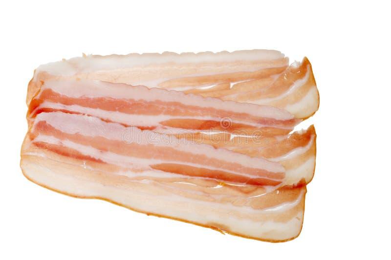 Alimento della pancetta affumicata della carne isolato sopra priorità bassa bianca fotografie stock