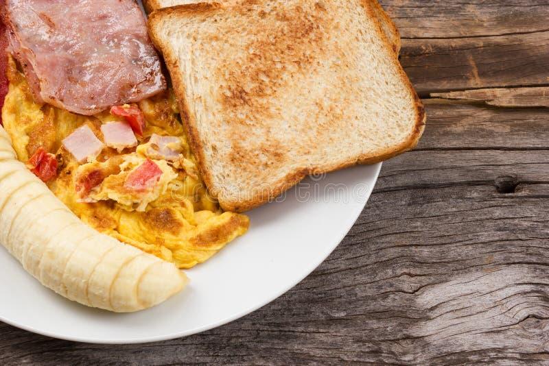 Alimento di prima colazione sulla tavola di legno fotografia stock libera da diritti