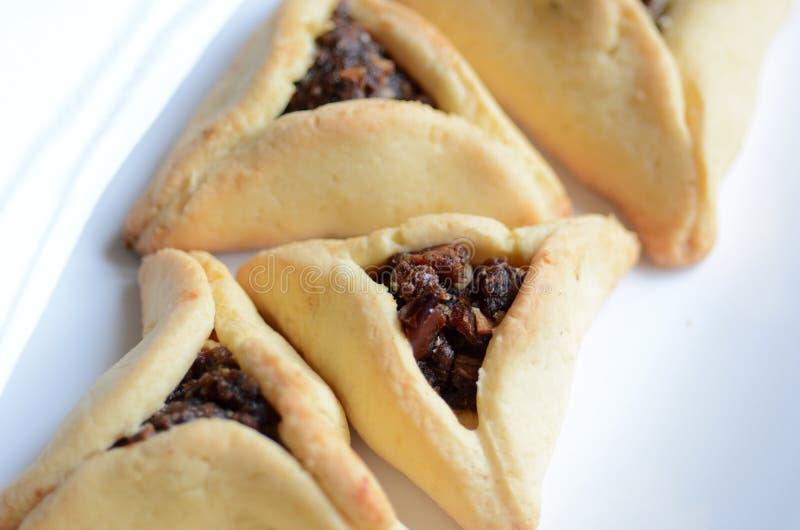 Alimento ebreo di festa di Purim - Hamentashen, Ozen Haman fotografie stock libere da diritti