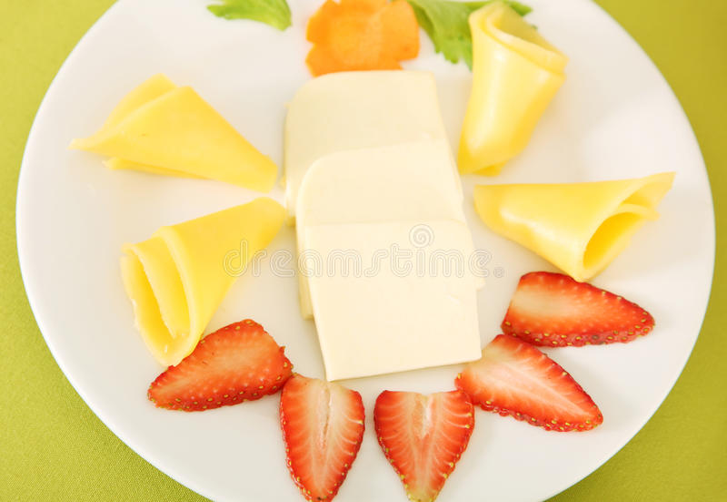Alimento, queso y fresa fotografía de archivo
