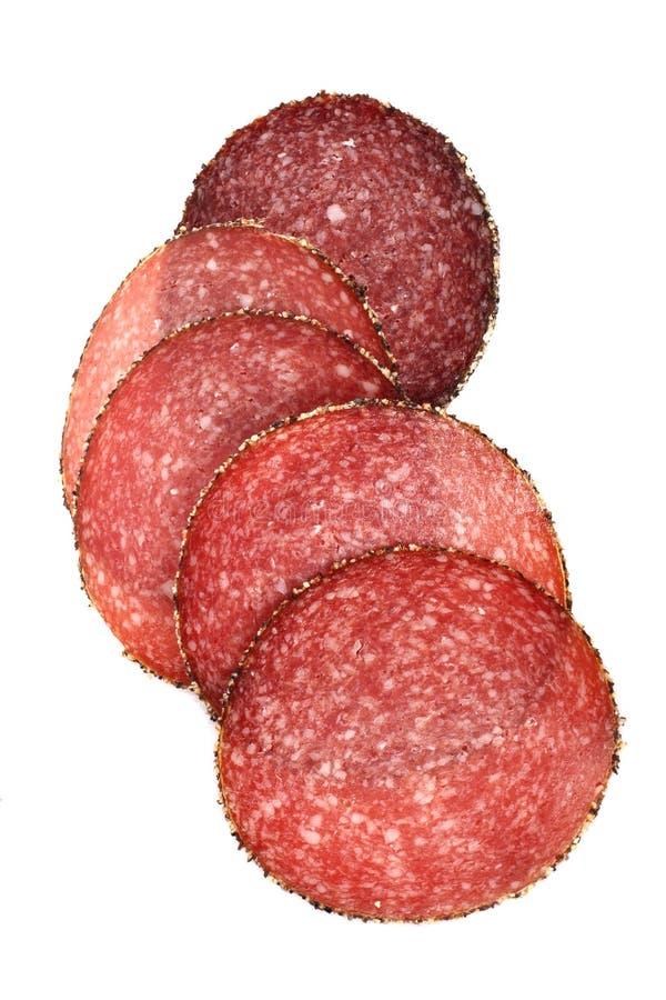 Alimento - salsiccia tedesca del salame del pepe affettata fotografia stock libera da diritti