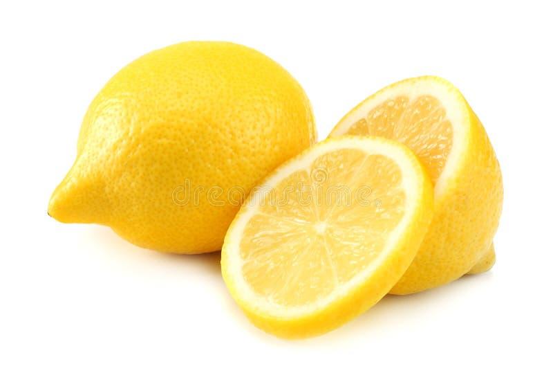 Alimento sano Limón con las rebanadas aisladas en el fondo blanco fotografía de archivo libre de regalías