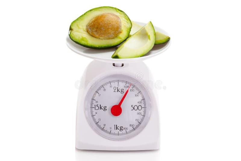 Alimento sano sulla scala dell'equilibrio immagine stock