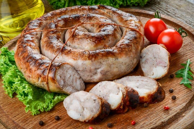 Alimento saporito e sano fritto domestico della salsiccia, fotografie stock
