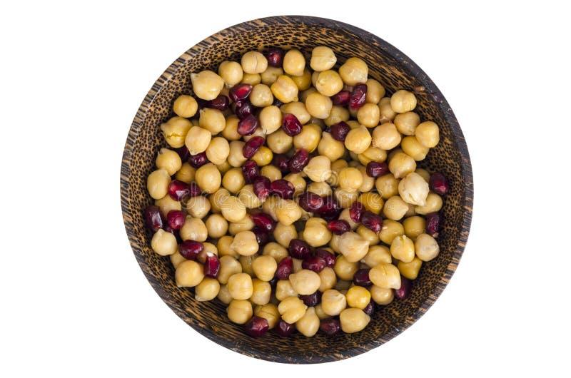 Alimento vegetariano sano, ceci bolliti con i semi del melograno fotografia stock