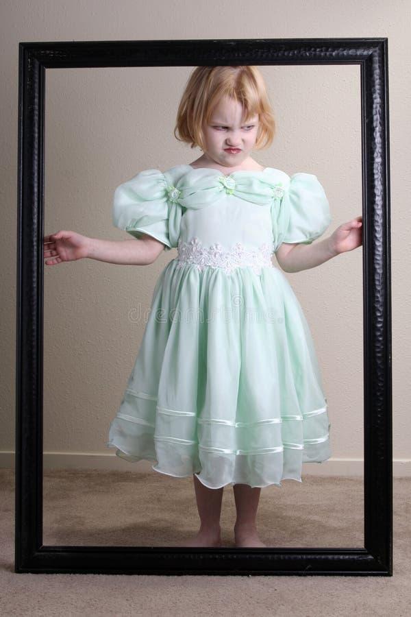 Alineada infeliz del verde de la niña enmarcada fotografía de archivo libre de regalías