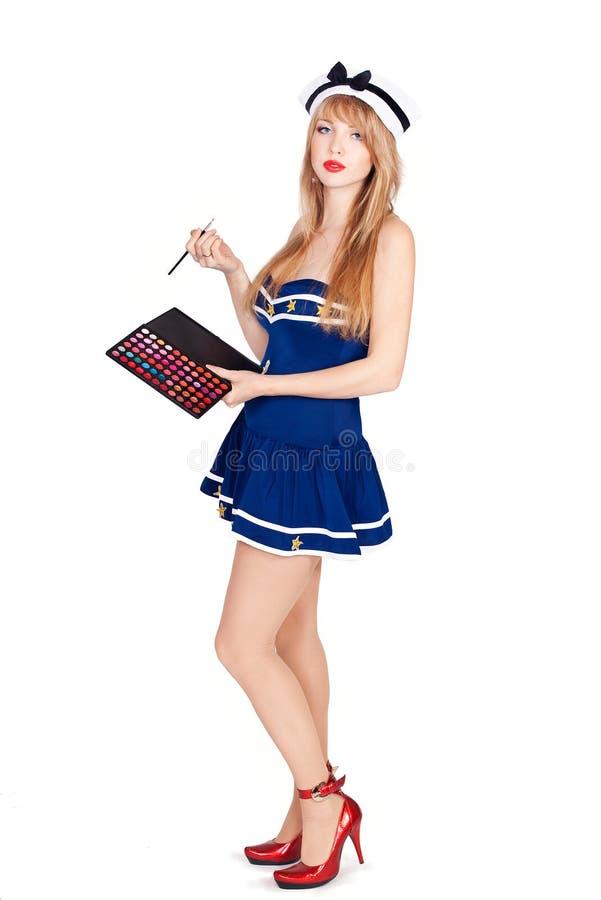 Alineada rayada marinero que desgasta de la mujer atractiva hermosa foto de archivo libre de regalías