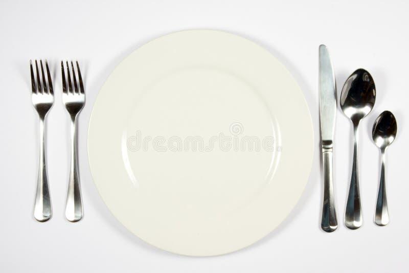 Aliste para la cena imagenes de archivo