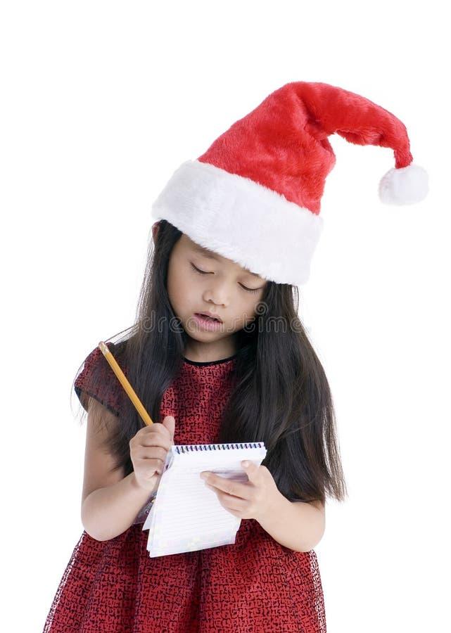 Aliste para la Navidad que hace una lista foto de archivo libre de regalías