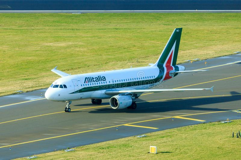 Alitalia Airbus A319. An Alitalia Airbus A319 taxiing on taxiway royalty free stock photos