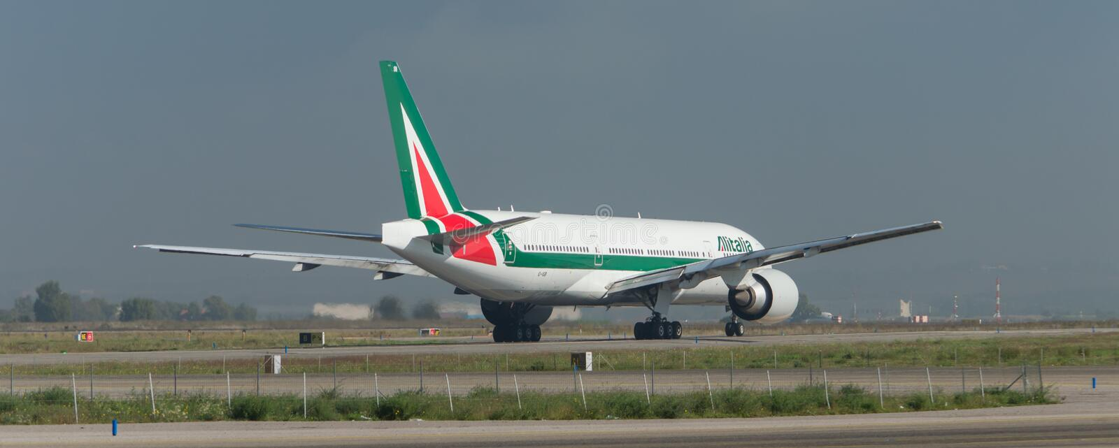 Alitalia Boeing 777 on the runway royalty free stock photo