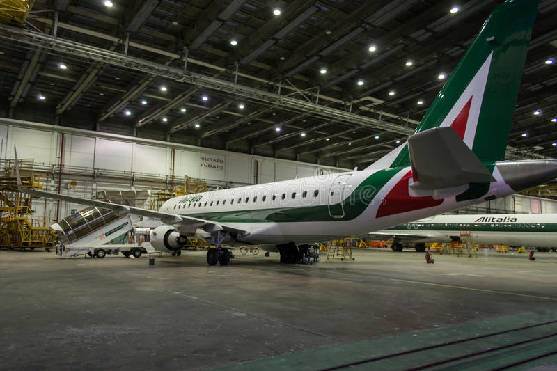 Download Alitalia Embraer In Hangar By Night Editorial Photography - Image of aircraft, high: 33644882