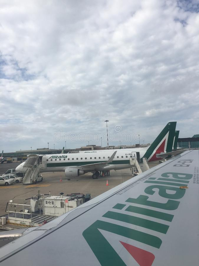 Alitalia regional jets parked on the tarmac royalty free stock images