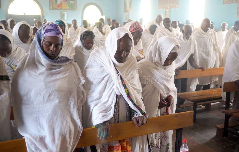 Alitena, Ethiopia - 1 June 2019 : Men and women attend a Catholic Mass in an Ethiopian Church. Alitena, Ethiopia - 1 June 2019 : Men and women attending a royalty free stock photos