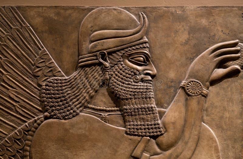 Alivio antiguo de dios asirio imagen de archivo libre de regalías