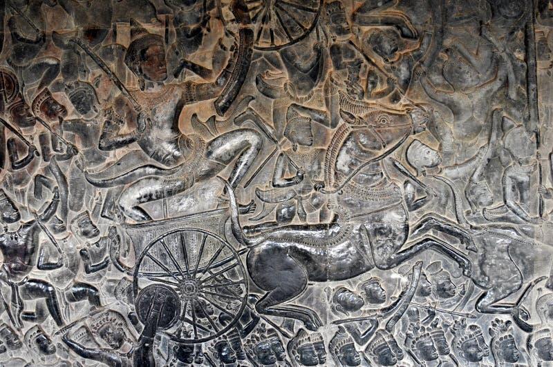 Alivio de Camboya - de Bas del templo de Angkor Wat foto de archivo libre de regalías
