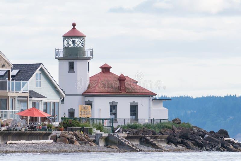 Alki Point Lighthouse le jour nuageux photographie stock