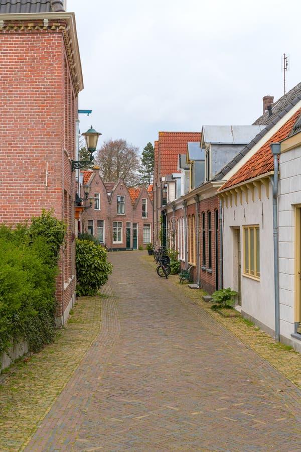 Alkmaar, Nederland - April 12, 2019: Weergeven van de straten van Alkmaar stock afbeeldingen