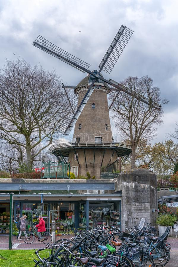 Alkmaar, the Netherlands - April 12, 2019: Beautiful traditional Dutch windmill in Alkmaar, Netherlands royalty free stock photo
