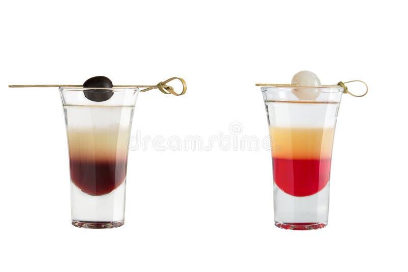 Alkoholskott på en vit bakgrund shots två royaltyfria foton