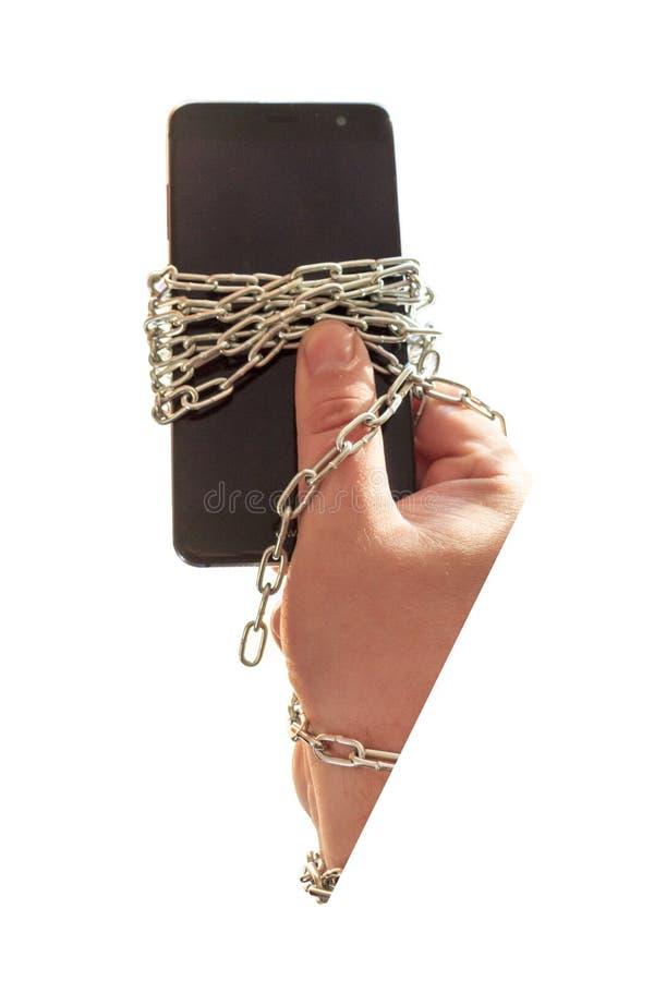 Allí ` s un teléfono en mi mano Están en una cadena Hay vietado fotos de archivo libres de regalías