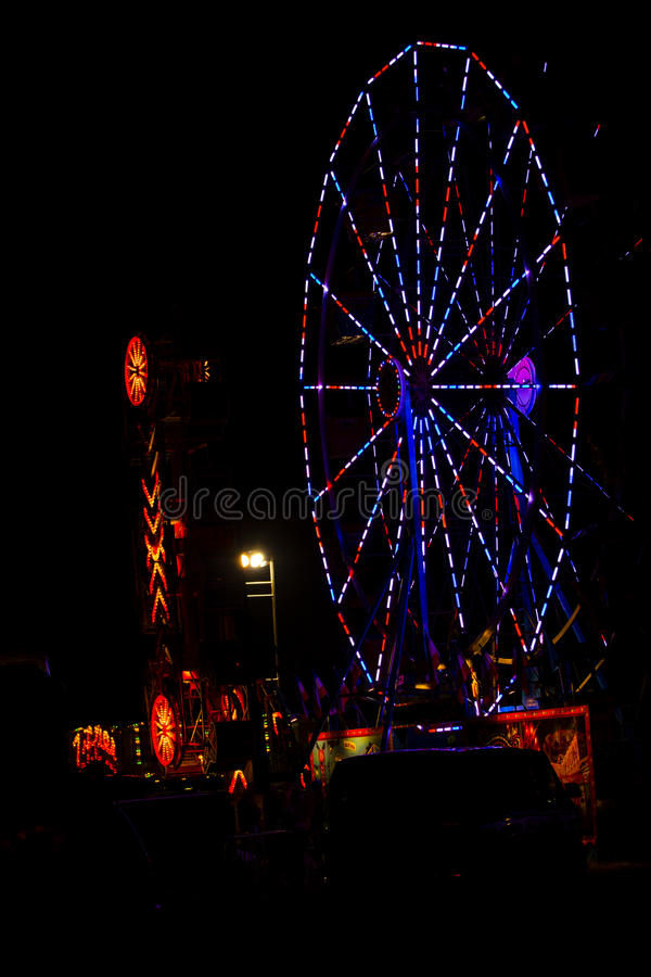 All American:Red, White and Blue July 4th Ferris Wheel in Carnival at Night. A summer festival to celebrate the American holiday of July 4th, Independence Day royalty free stock photography