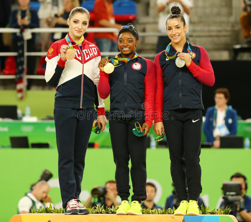 All-around gymnastics medalists at Rio 2016 Olympics Aliya Mustafina of Russia (L),Simone Biles and Aly Raisman of USA. RIO DE JANEIRO, BRAZIL -AUGUST 11, 2016 royalty free stock image