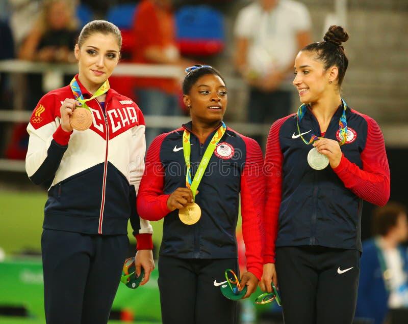 All-around gymnastics winners at Rio 2016 Olympic Games Aliya Mustafina L, Simone Biles and Aly Raisman during medal ceremony. RIO DE JANEIRO, BRAZIL - AUGUST 11 stock photography