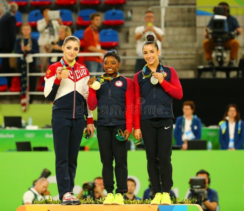 All-around gymnastics winners at Rio 2016 Olympic Games Aliya Mustafina L, Simone Biles and Aly Raisman during medal ceremony. RIO DE JANEIRO, BRAZIL - AUGUST 11 stock photos