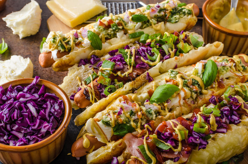 All beef hot dog. With cabbage, bacon, cheese royalty free stock photography