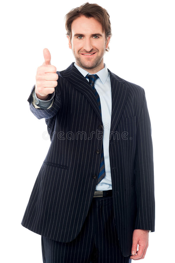 All the best! Do well. Isolated male manager gesturing thumbs up stock image