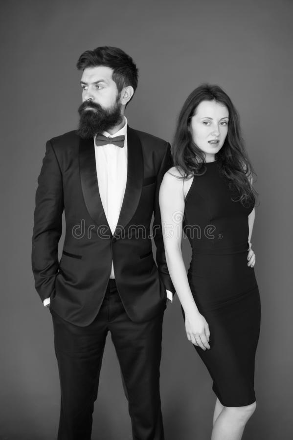 All black dress code. Official event concept. Man bearded wear tuxedo girl elegant dress. Visiting event or ceremony stock images