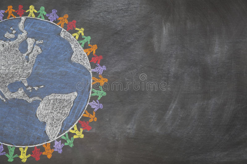 All the children of the World. A hand drawn chalkboard shows multi-ratial people holding hands around the world to show care for the earth, peace, and unity stock images