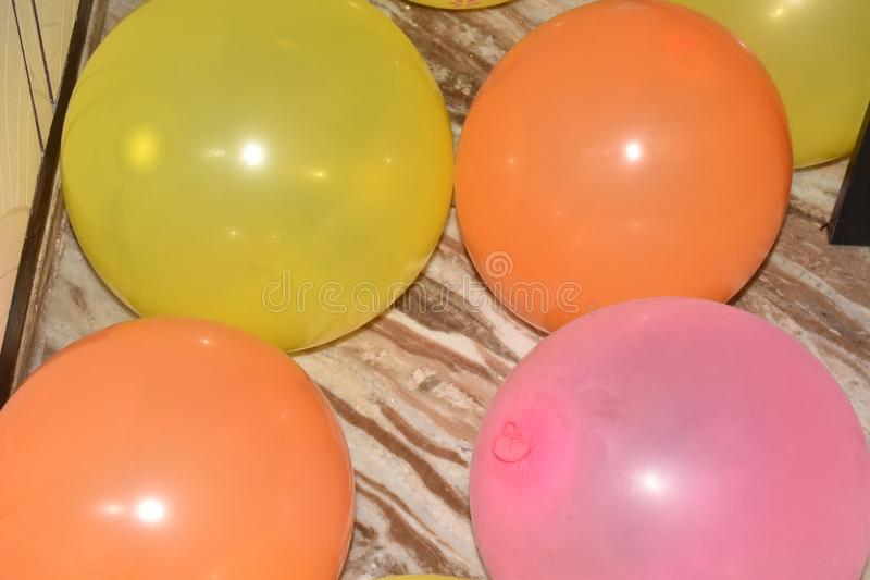 ALL COLOR BALLOONS IN THE FLOOR royalty free stock photography