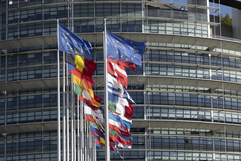 All EU Flags European Union flag waving in front of European Parliament, headquarter of the European Commission European. STRASBOURG, FRANCE - JUNE  23, 2018 royalty free stock image