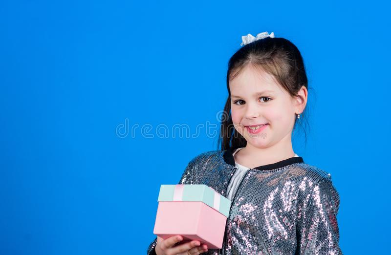 All eyes on you. Special happens every day. Girl with gift box blue background. Black friday. Shopping day. Cute child royalty free stock photo