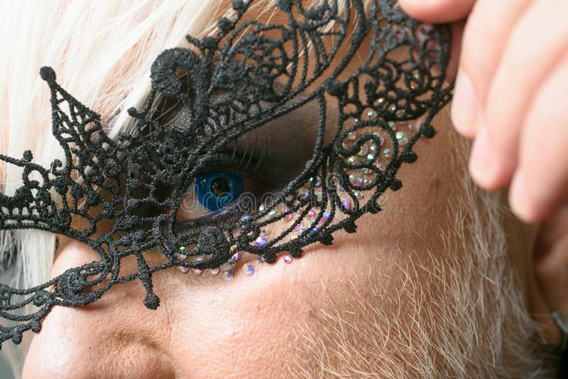 All the freaky people make the beauty of the world. Fetish fashion. Transgender man wear lace mask. BDSM fashion. Accessory. Heterosexual man with male makeup stock photos