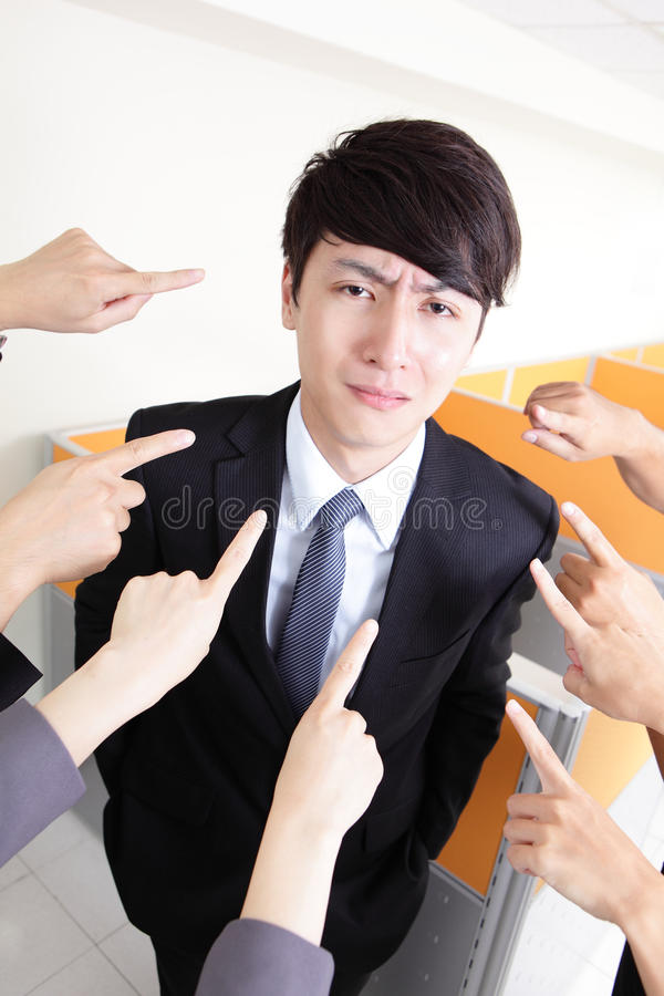 All hands finger pointing at a businessman stock photo