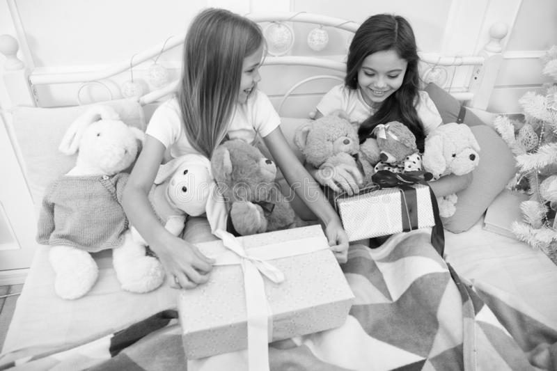 All I want from Christmas is gift. Happy little children hold gift boxes. Cute girls with presents in bed. Opening. Presents on Christmas morning. New Year stock photos
