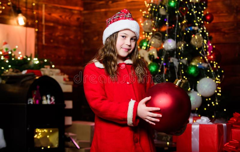 All I want for Christmas. Happy new year. Little girl in red hat. Shopping day. Santa claus little girl. Christmas. Shopping. Elf child. Xmas tree. Holiday stock photo