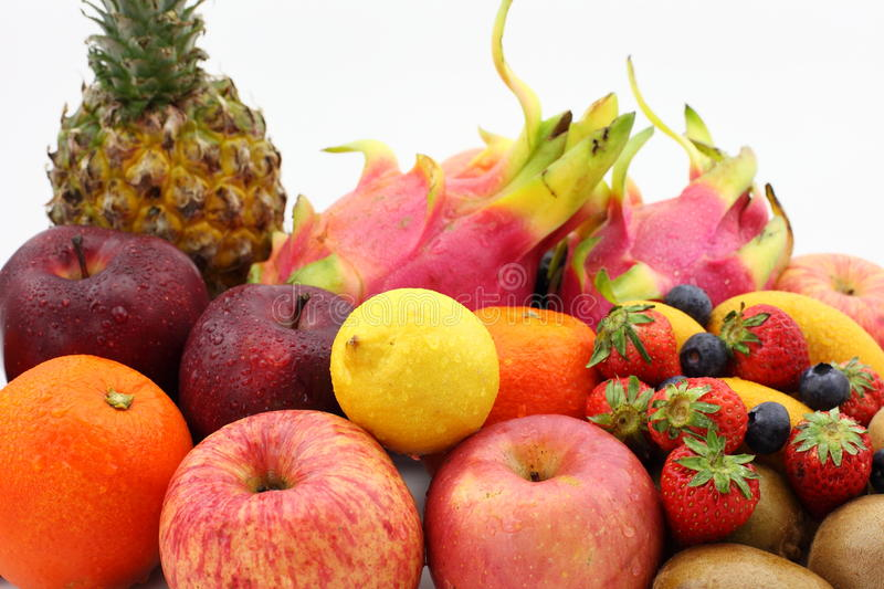 All kinds of fruit. The picture is all kinds of fruit, they are pitaya, mango, orange, red delicious apple,Strawberry, apple, lemon,blueberry,kiwi fruit royalty free stock images