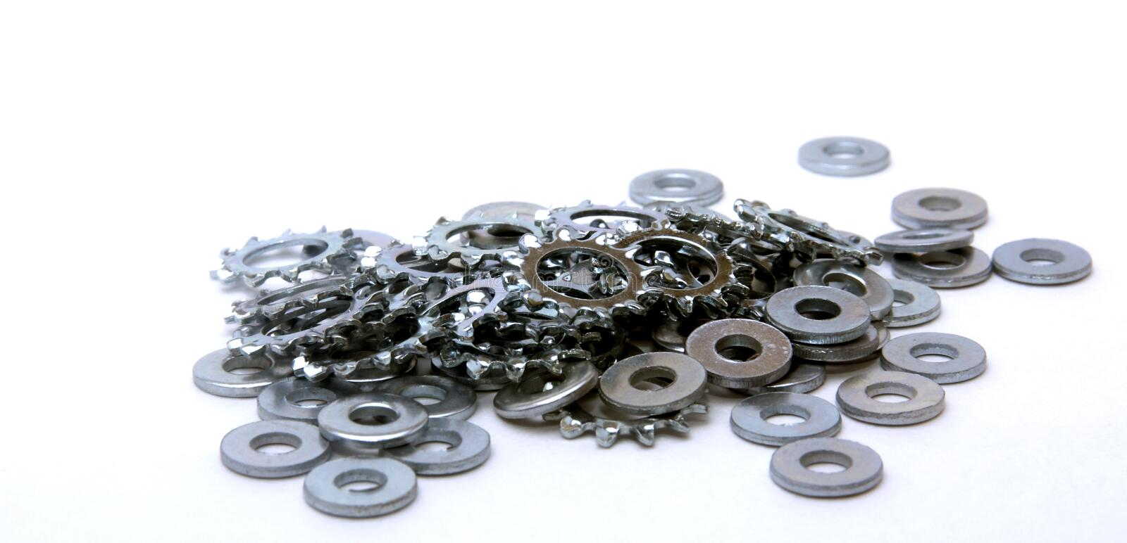 All Kinds Of Washers. A Large pile of locking Washers along with normal ones royalty free stock image