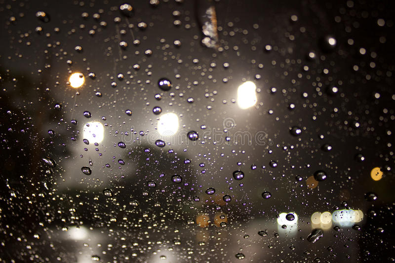 All of the lights. Rain drops refract the night`s lights stock photos