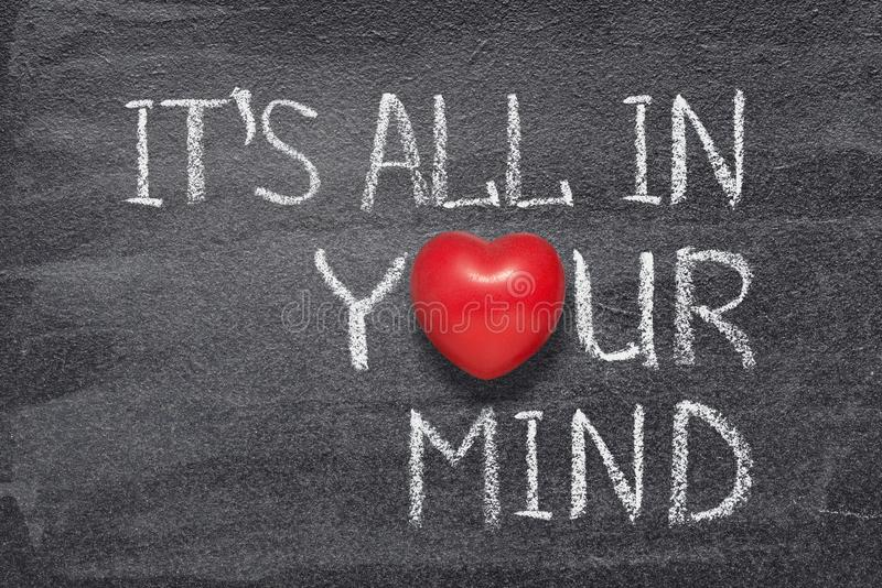 All in mind heart. It is all in your mind phrase written on chalkboard with red heart symbol instead of O stock illustration