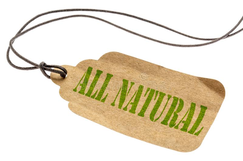 All natural isolated tag. All natural sign - a paper tag with a twine isolated on white royalty free stock photo