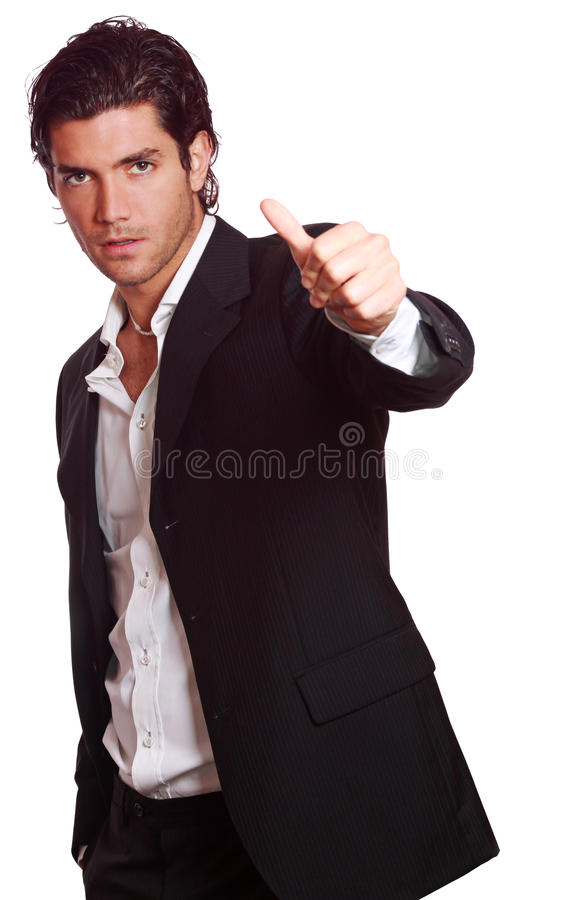 All is Ok. Stylish man with thumb up . Success concept studio shot. Isolated on white stock photography