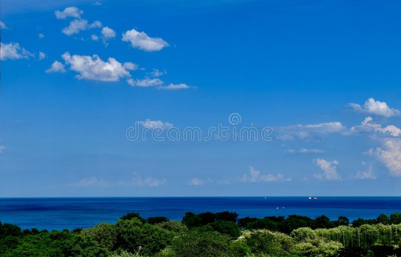 All Quiet On Lake Michigan. This is a summer picture Lake Michigan beyond Lincoln Park on a quiet afternoon located in Chicago, Illinois in Cook County.  This royalty free stock image