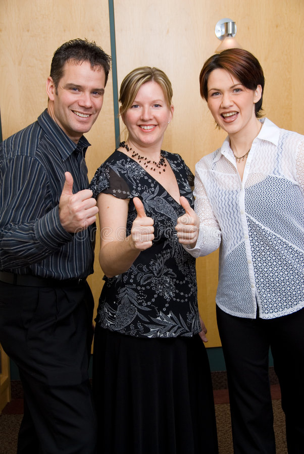 All's good. 3 colleagues with their thumbs up royalty free stock images