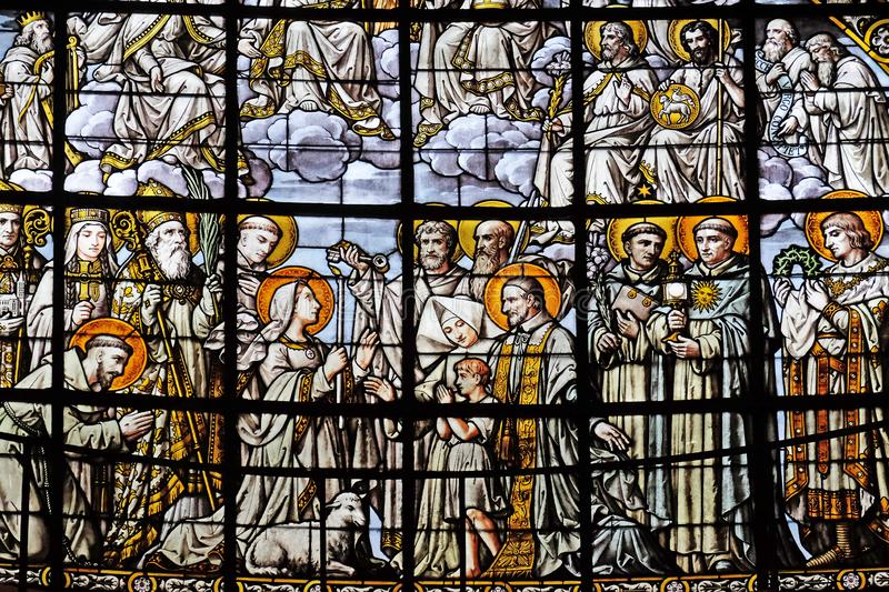 All Saints. By Edouard Amedee Didron, stained glass window in Saint Thomas Aquinas in Paris, France royalty free stock photo